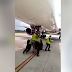 [VIDEO] Hahaha! Man left shocked and suprised after seeing Nigerian airport officials push an airplane