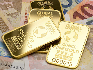 gold to protect from sinking global currencies