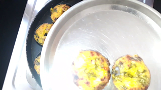 image of taking out vadas in a plate