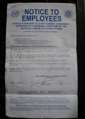 Kent Security Notice of NLRA Rights of employees with Gil Neuman signature.