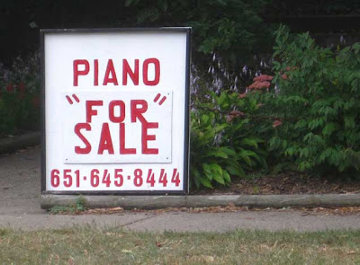 Hand-painted sign reading PIANO FOR SALE with FOR inside double quotation marks