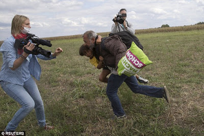 Camerawoman petra laszlo who tripped syrian refugess