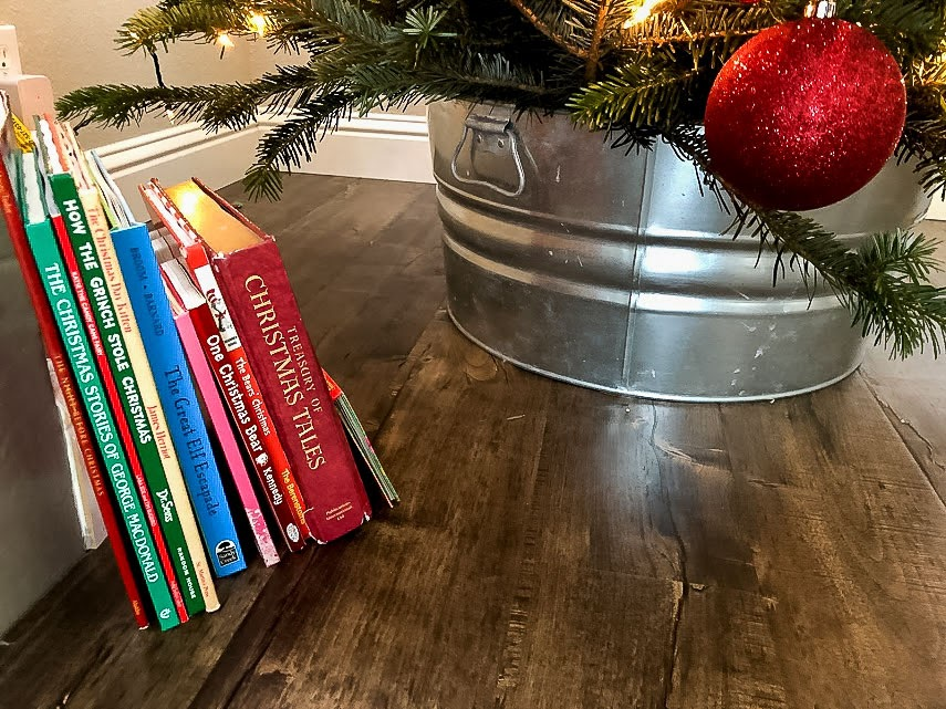 Galvanized Bucket for the Christmas Tree Stand with Christmas books next to it