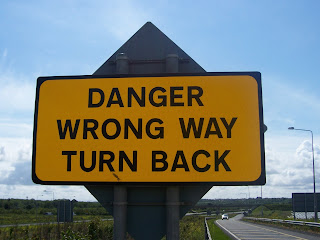 wrong way sign turn back