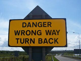 wrong way sign turn back