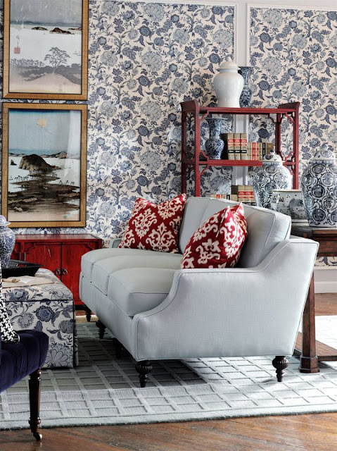 Traditional living room decor and interior design by Barclay Butera with a mix of prints in red, white, and blue. #traditional #livingroom #red,whiteblue #barclaybutera