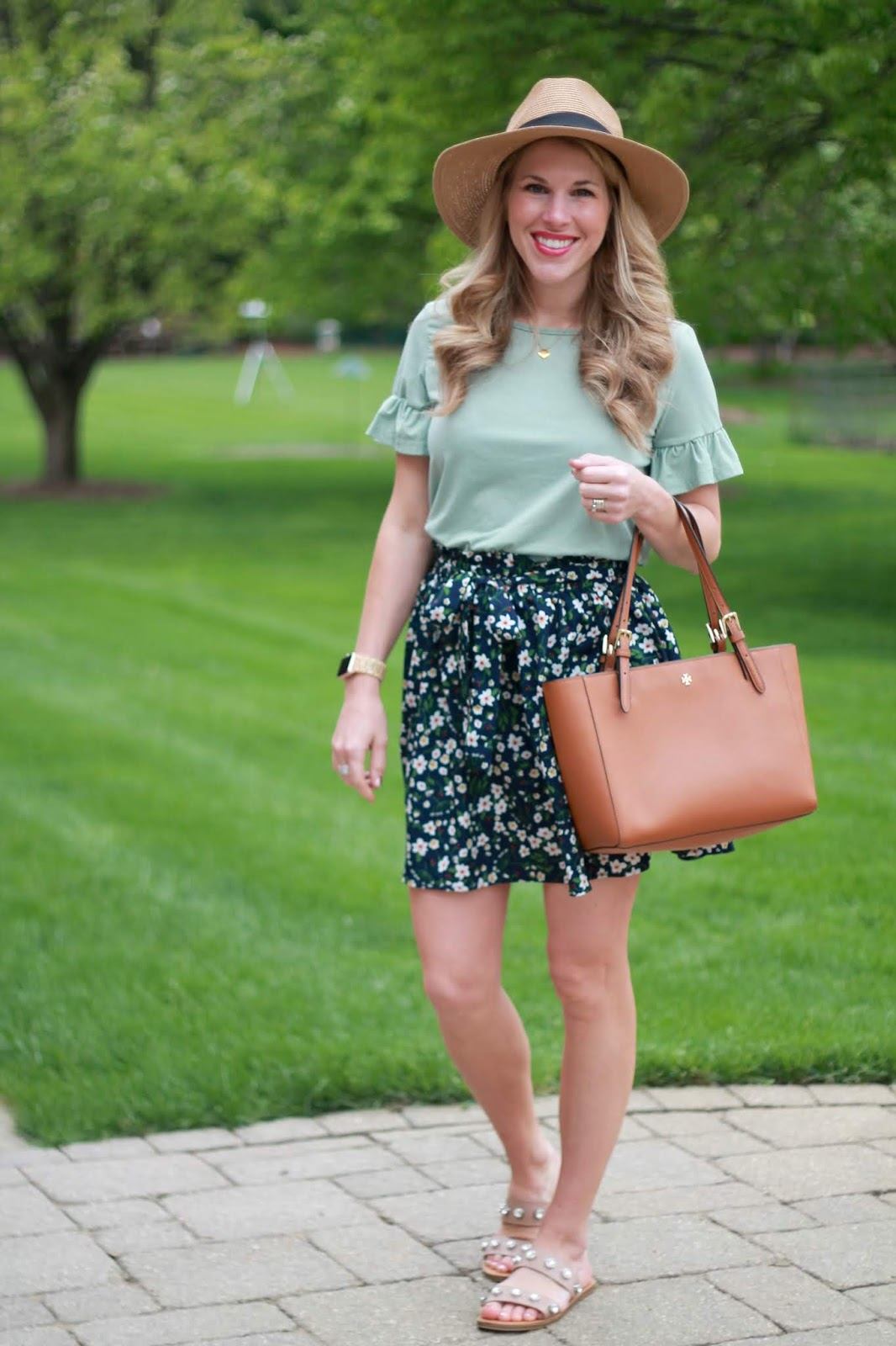 green ruffle top, blue floral paper bag skirt, crystal studded sandals, cognac tote, straw fedora