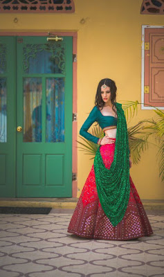 Beautiful Indian Model Girl In Teal And Pink Lehenga With Mirror Work On Border Side And Green Shimmery Dupatta.