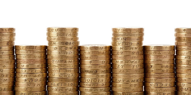 Photo of pound coins stacked