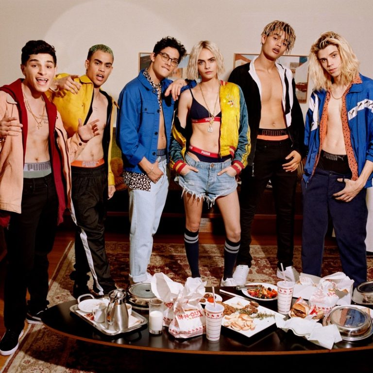 Cara Delevingne poses with PRETTYMUCH for PUMA Bodywear campaign
