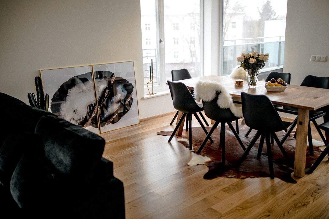 living room dining room cow rug under table