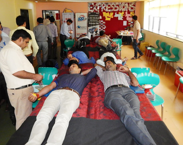 Volunteers donating blood during Blood Donation Camp organised by Connect Broadband on the occasion of Raksha Bandhan
