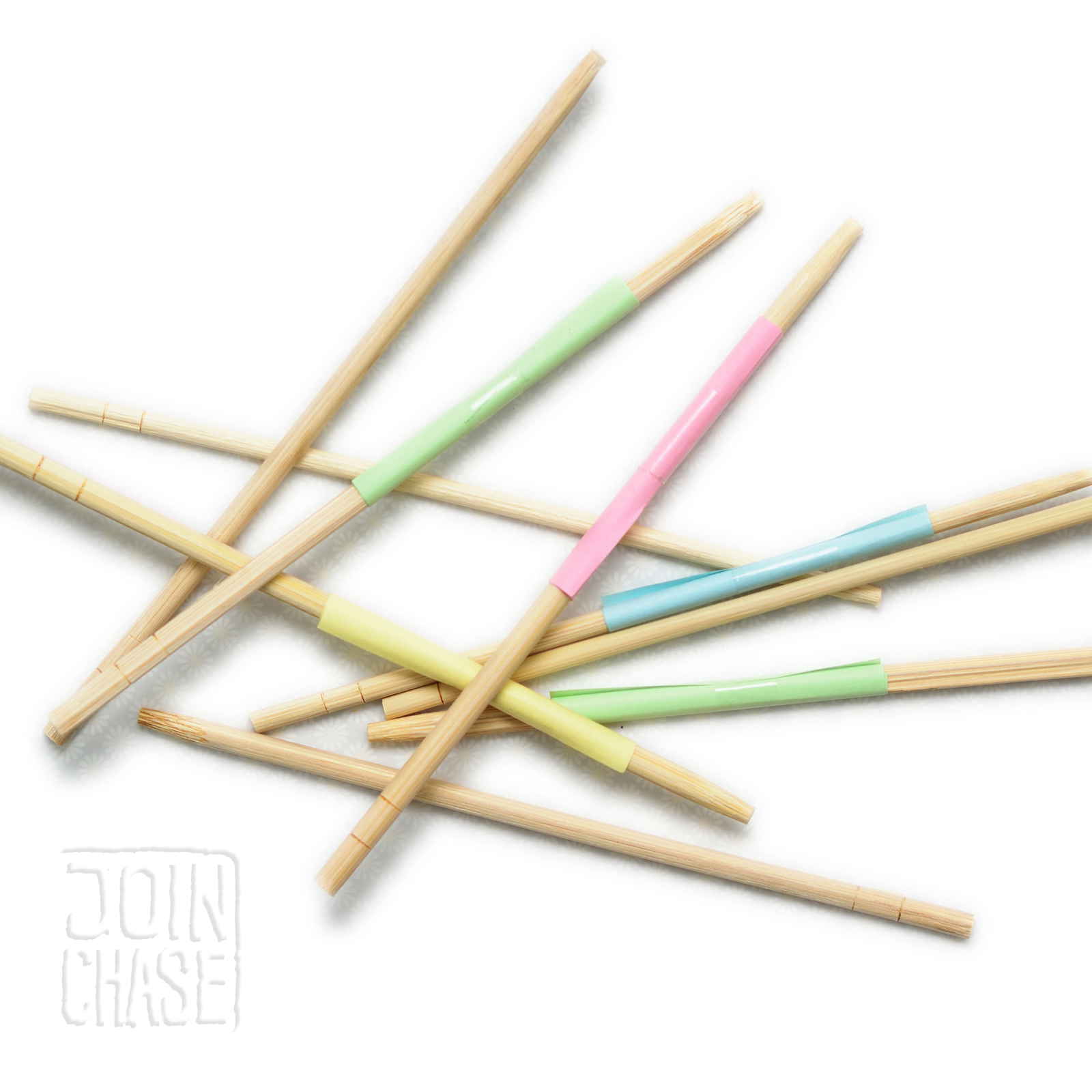Wooden chopsticks with paper rolled around them used to play Pick-up Sticks in an English lesson.