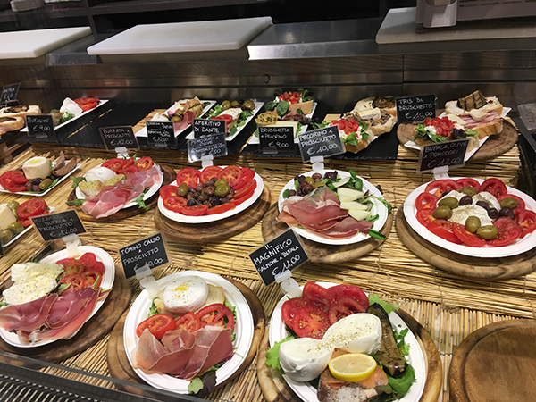 Charcuterie, cheese, and olive platters from Mercato Centrale in Florence, Italy