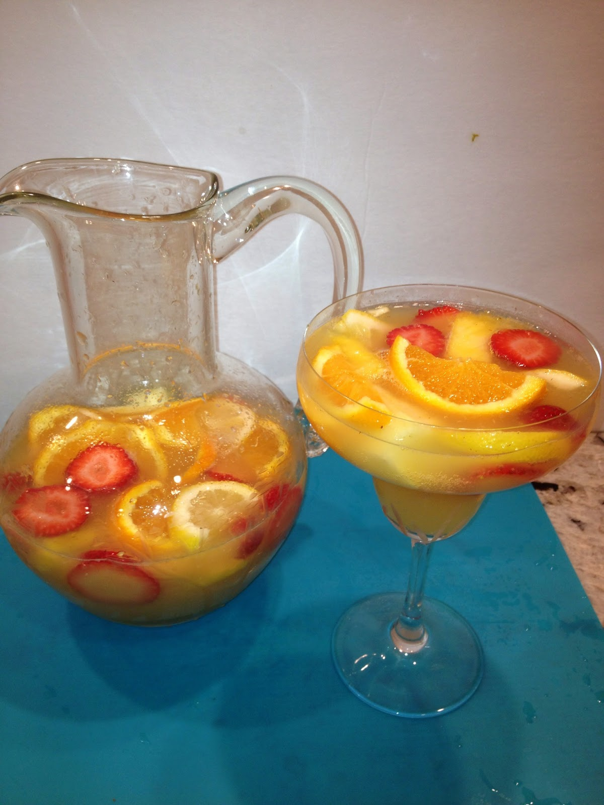 A large pitcher of white wine sangria with fruit