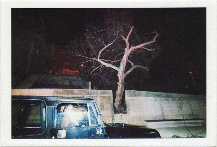 dirty photos - umbra - a night street photo of a couple inside a jeep in rethymno