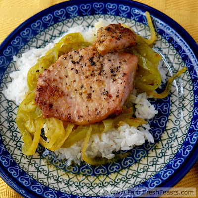 Pork chops baked with curry-seasoned green tomatoes and onions served over rice.