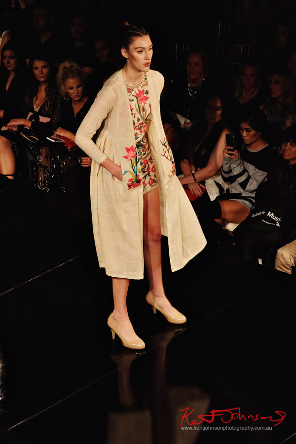 Short embroidered dress and long coat. Purvi Doshi shows at New York Fashion Week with Art Hearts Fashion. Photography by Kent Johnson for Street Fashion Sydney.