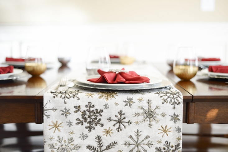Christmas party tablescape with snowflake table runner