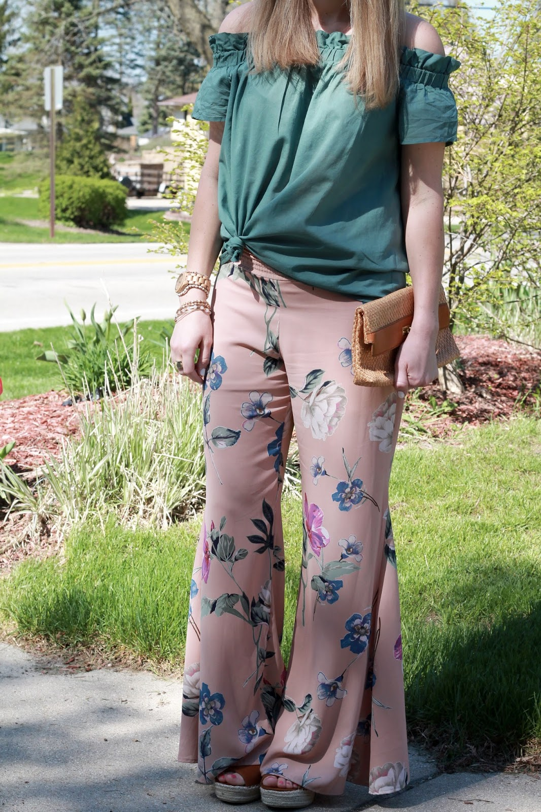 pink floral palazzo pants, green OTS top, Steve Madden wedge sandals, straw clutch