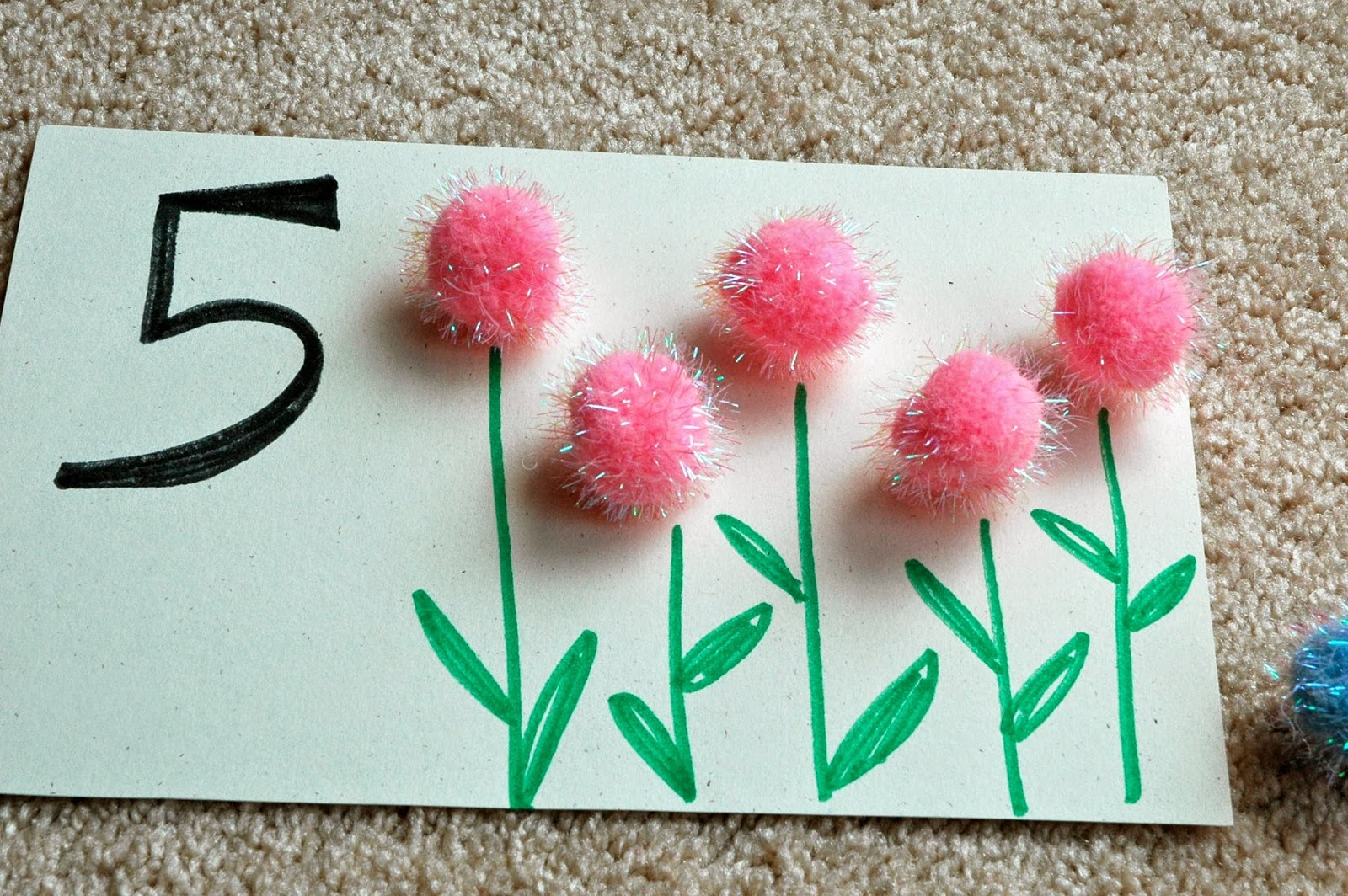 pom poms on flower number card for math activity