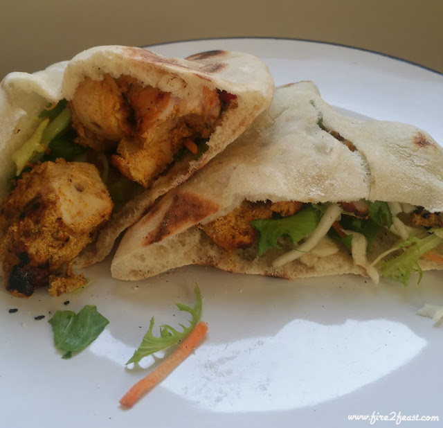 Homemade tandoori chicken in homemade pita bread