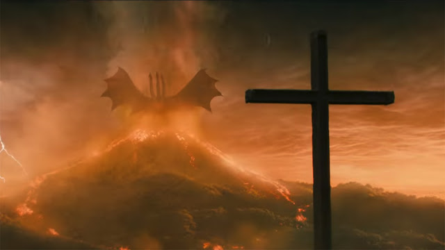 giant monster, volcano, and a cross