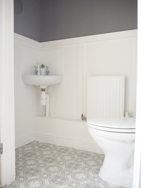 DIY wood panelling and victorian tile-effect vinyl floor transform this downstairs toilet from boring to beautiful. £100 spent on this makeover and no DIY skills needed