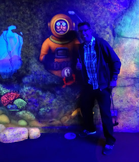 Meeting Mr Mulligan under the sea in the blacklit indoor minigolf course in Stevenage last year