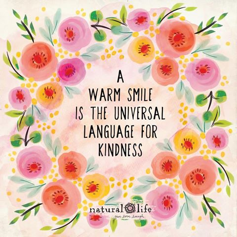 a warm smile is the universal language of kindness