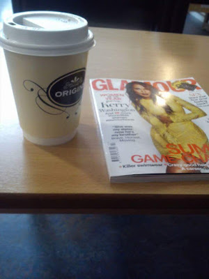 glamour magazine and tea cup