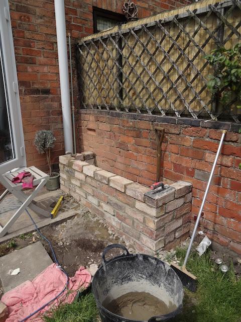 DIY brick seating in garden