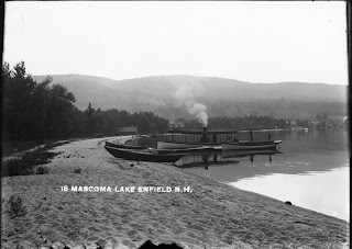 A black and white photograph of Mascoma Lake.