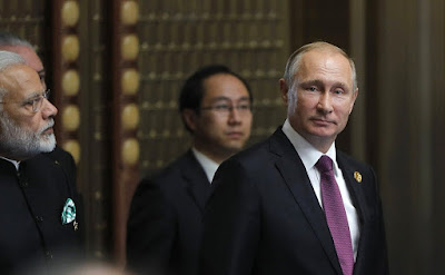 Vladimir Putin before the beginning of the BRICS Leaders' meeting in the expanded format.