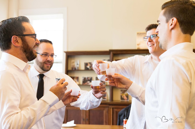 Groomsmen doing a shot