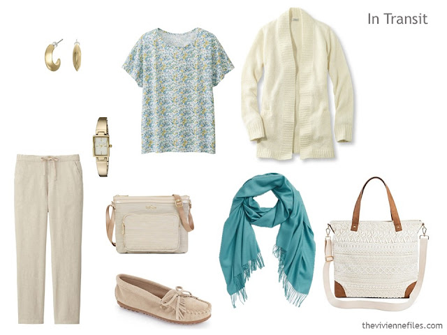 A travel outfit including beige trousers, a floral tee shirt and ivory cardigan.