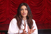 Priyanka Chopra in White Shirt and Colorful Skirt at Baywatch Press Conference  15th May 2017 ~  Exclusive 03.jpg