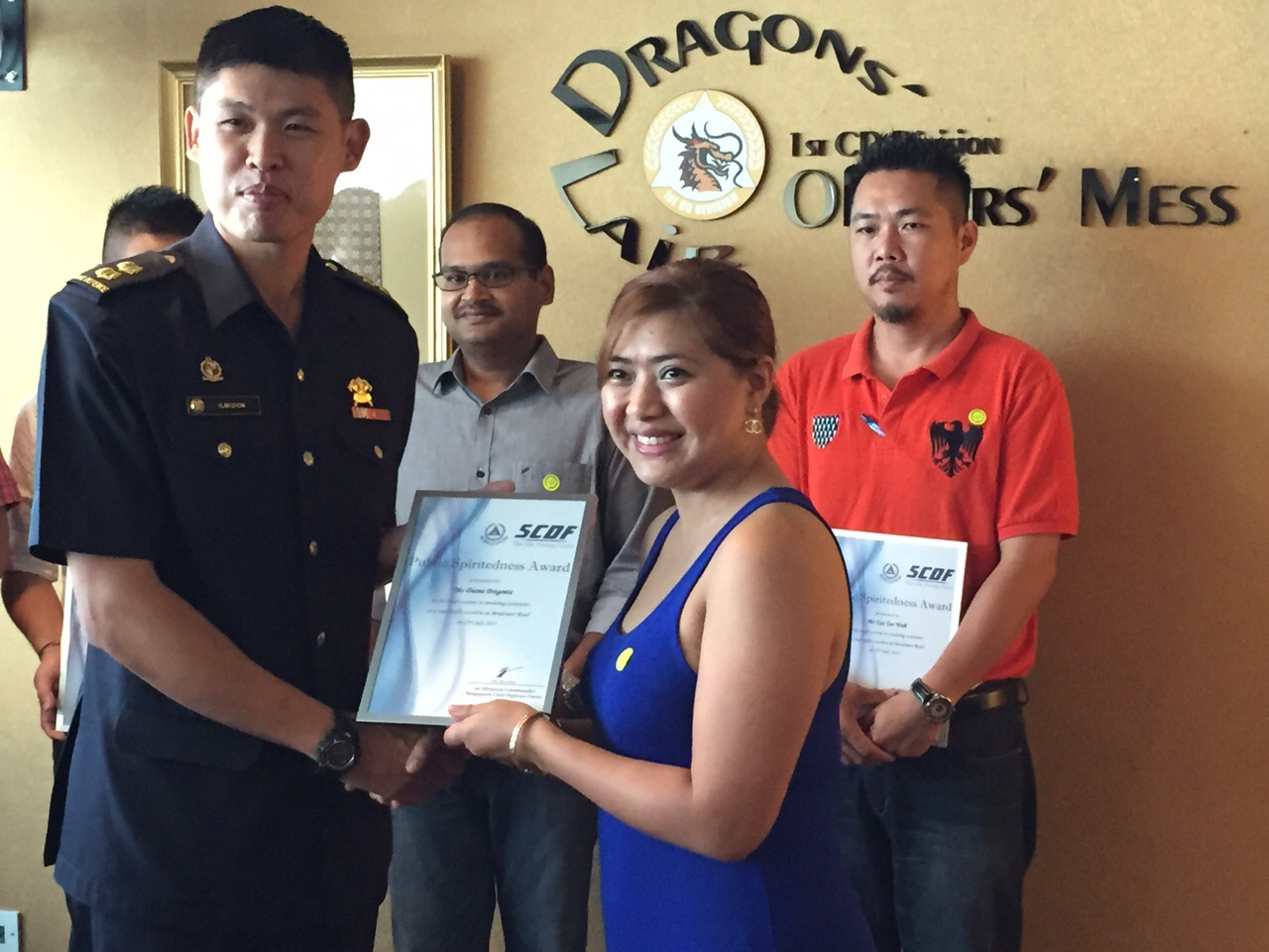 Ms Diana Bregente, receiving her certificate from the SCDF