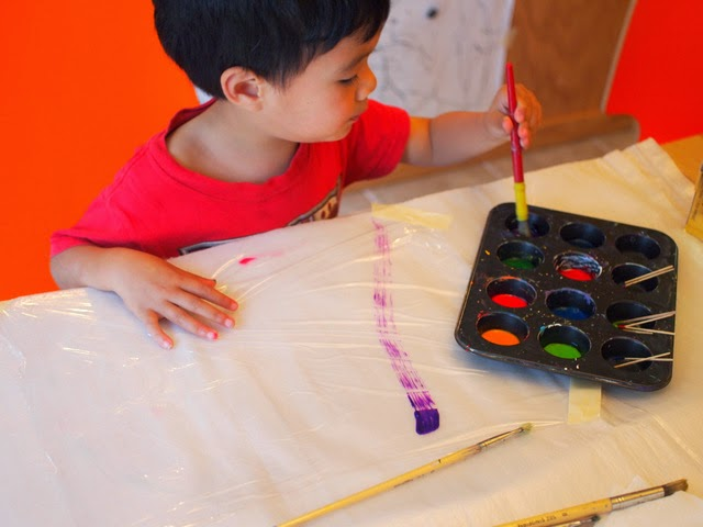 painting sun catchers with preschoolers- easy and fun kid art