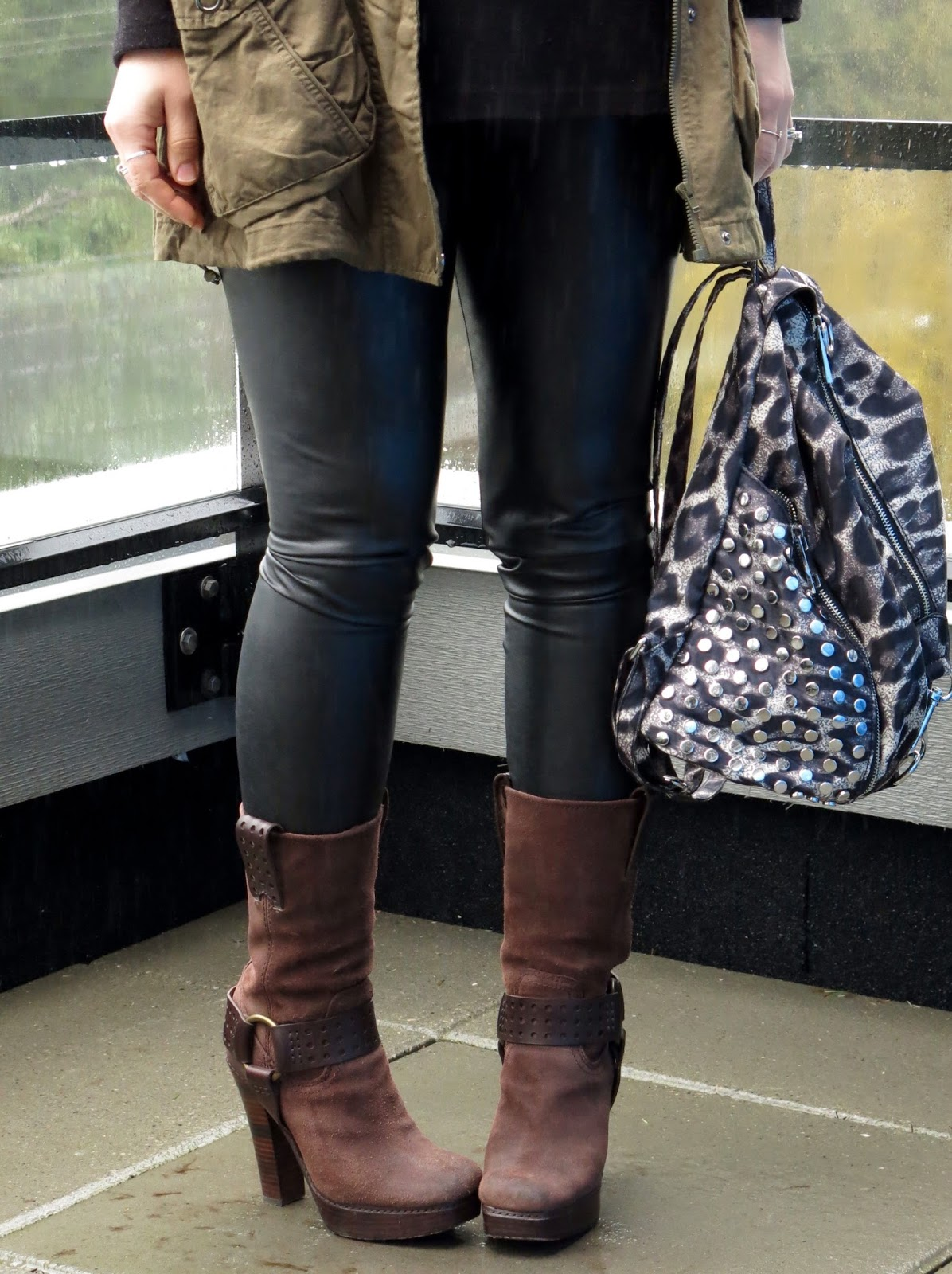 faux-leather leggings, leopard-print backpack, and Frye booties