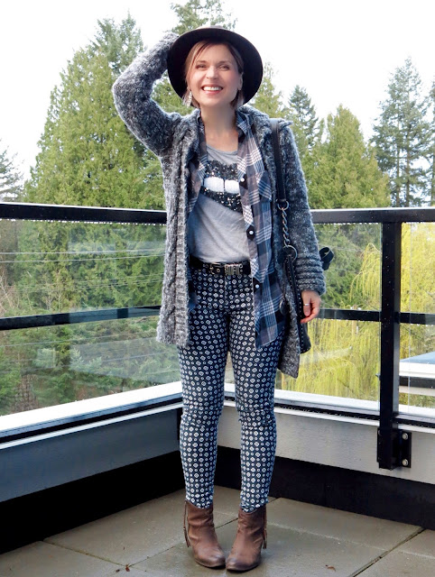 styling a sequinned t-shirt with plaid shirt, sweater-coat, printed pants, booties, and a fedora