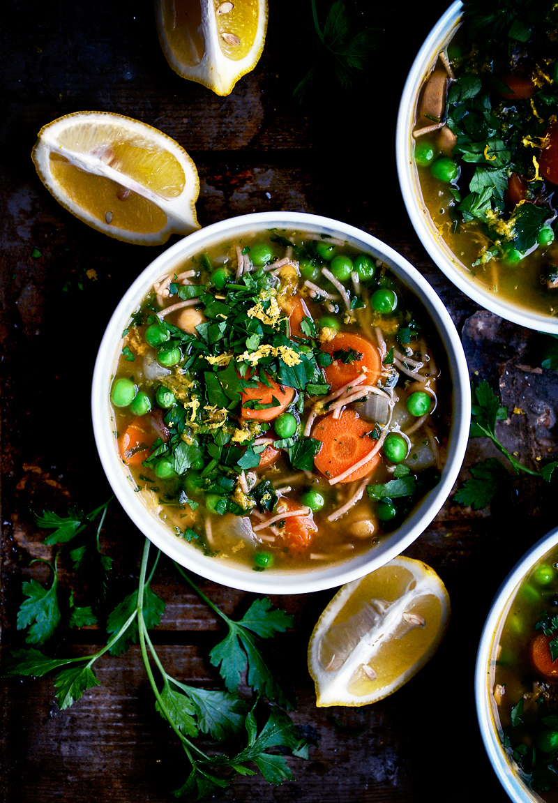 Vegan chickpea noodle soup with bright accents of parsley and lemon to lighten up this otherwise wintery soup. With carrots, peas, and whole wheat noodles for a healthy vegetarian spin on the classic - and just as good to eat when you're sick or in need of comfort food.