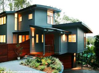 Perpaduan hijau dan coklat warna cat rumah minimalis bagian luar