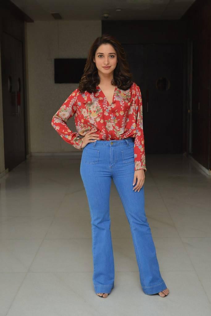 Actress Long Legs In Orange Top Blue Jeans Tamanna