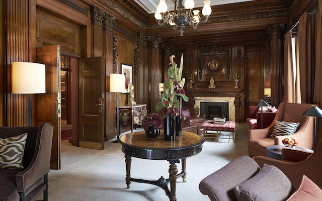 Luxury private club with dark paneling in Four Seasons London Ten Trinity Square