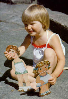 Image: Girl playing with paper dolls, by Janke