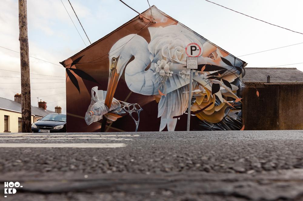 UK mural artist Samer's street art mural in Waterford Ireland for the Waterford Walls Festival