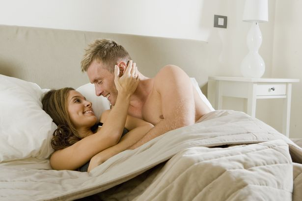 PROD-Young-couple-embracing-intimately-in-bed