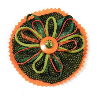Broche mariposa verdes y naranjas