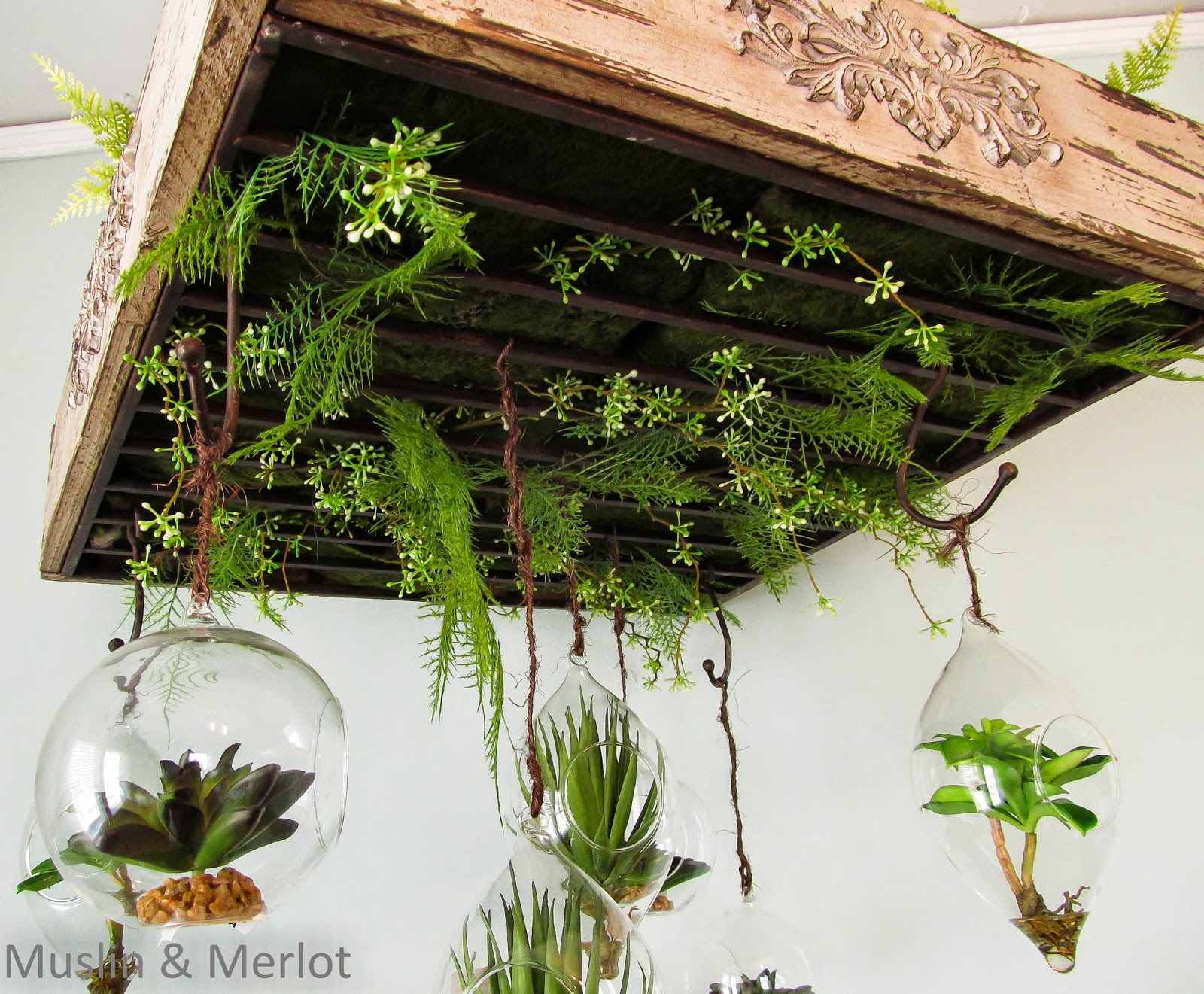 Moss, fern and hanging succulent chandelier.
